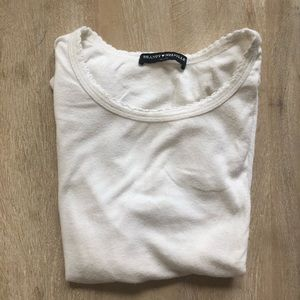 white T-shirt with scalloped details